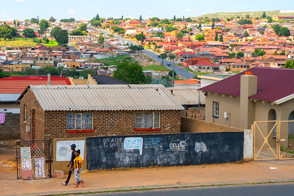 The changing face of Soweto with the original housing in the foreground and more affluent suburbs in the backgoround, Soweto, Johannesburg, South Africa, Africa