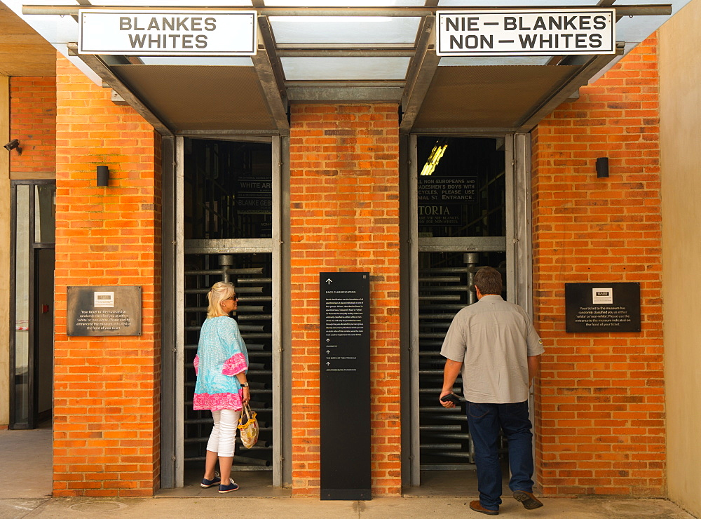 Outside the entrance to the Apartheid Museum showing the old whites and non-whites signs from apartheid era, Johannesburg, South Africa, Africa