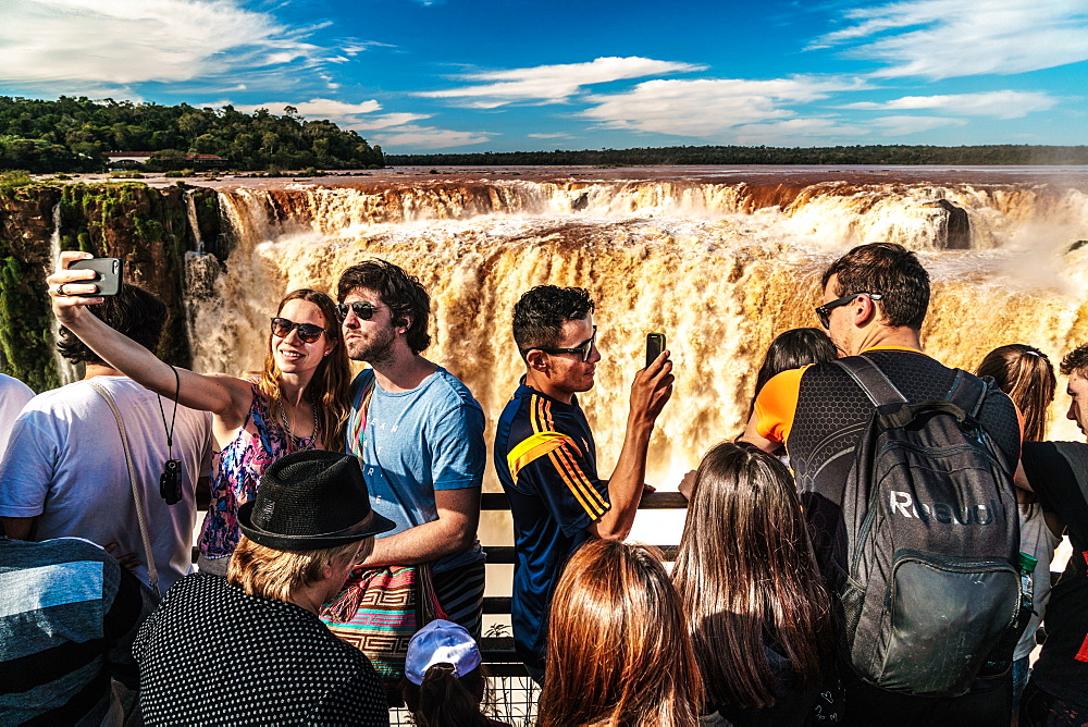 Selfie takers at the Garganta del Diablo (Devil's Throat), Iguazu Falls, UNESCO World Heritage Site, Iguazu, Argentina, South America - 450-4251