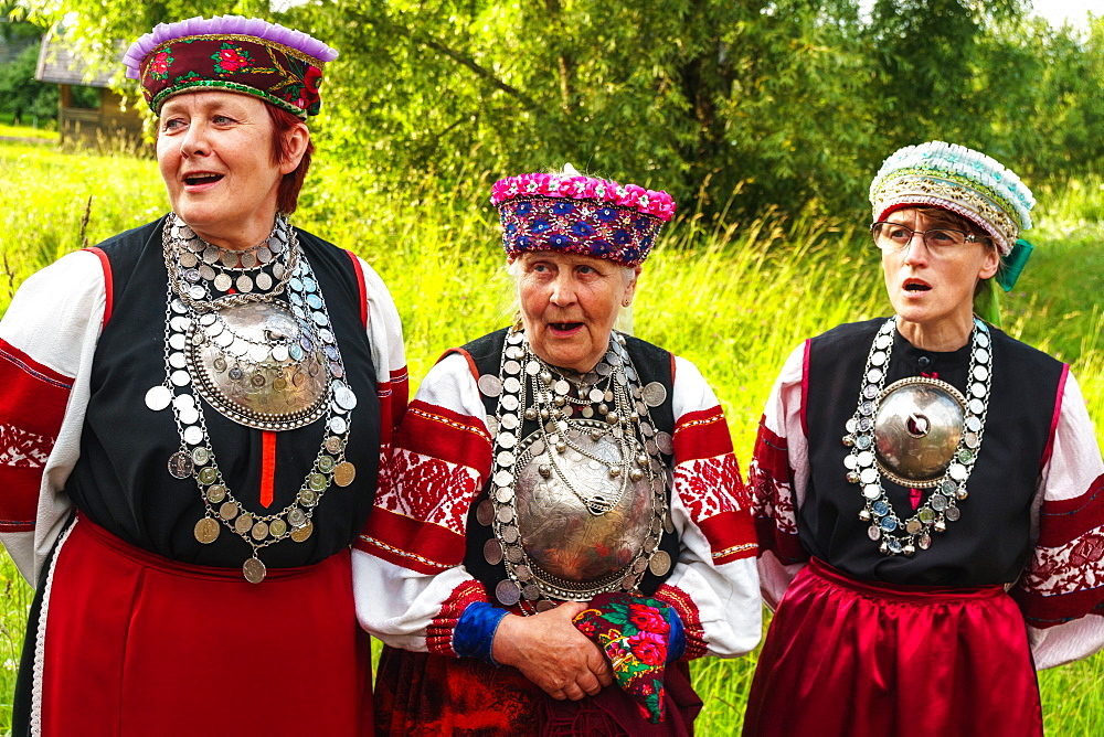 Three Seto women, singing polyphonically at a Feast Day, Uusvada, Setomaa, SE Estonia, Europe - 450-4275