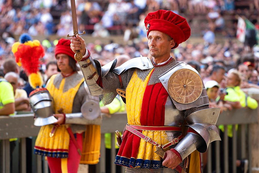At the pageant that precedes the Palio race, representatives of each neighbourhood parade in traditional costume, Siena, Tuscany, Italy, Europe - 450-4425