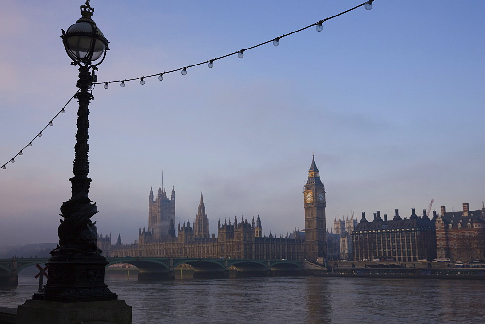 Early misty morning view of Big Ben and the Houses of Parliament across Westminster Bridge, London, England, United Kingdom, Europe