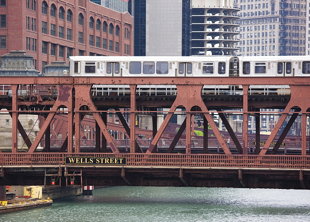 An El train on the Elevated train system crossing Wells Street Bridge, Chicago, Illinois, United States of America, North America - 462-2258