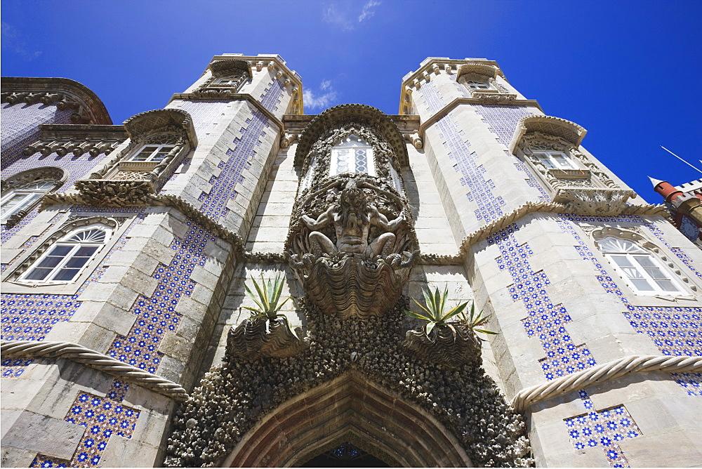 Fierce gargoyle above archway, Pena National Palace, UNESCO World Heritage Site, Sintra, Portugal, Europe