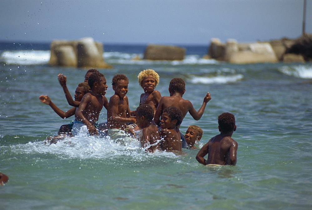 Boys playing in the sea, Lenakel, Tanna, Vanuatu, Pacific Islands, Pacific