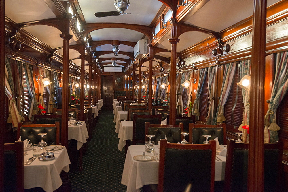 Galleried wood panelled Edwardian vintage dining coach on the Rovos Rail luxury train, Western Cape, South Africa, Africa