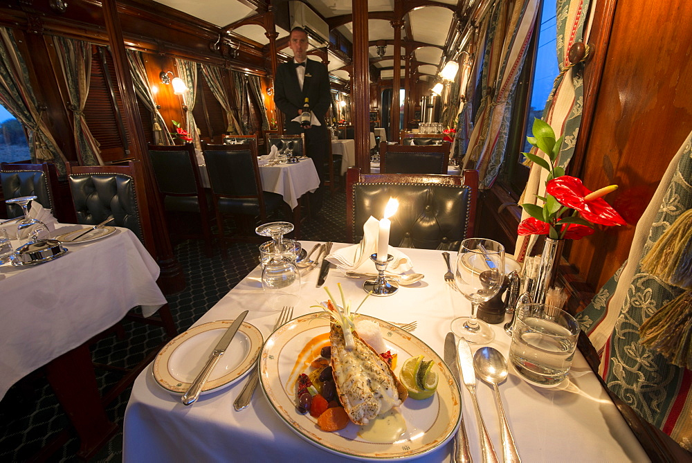 Dinner in the galleried wood panelled Edwardian vintage dining coach, Rovos Rail, South Africa, Africa