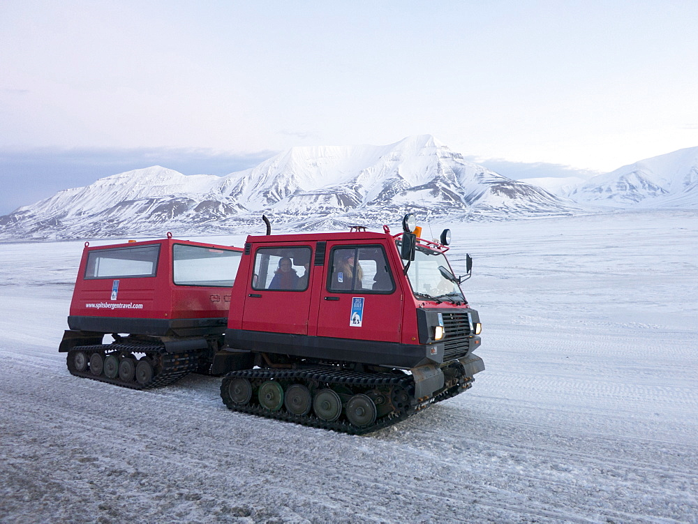 A snowcat ten wheeler tracked vehicle is used so that visitors and tourists can view landscapes protected from the winter cold, Svalbard, Arctic, Norway, Scandinavia, Europe