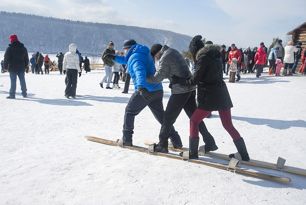 Siberians celebrate the festival of Maslenitsa with outdoor games such as group skiing, Irkutsk, Siberia, Russia, Eurasia