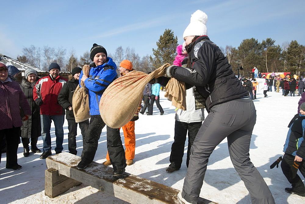 Siberians celebrate the festival of Maslenitsa with outdoor games, Irkutsk, Siberia, Russia, Eurasia