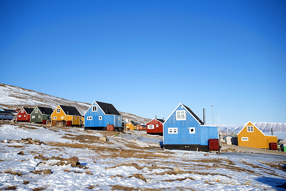 Colourful wooden houses in the village of Qaanaaq, one of the most northerly human settlements on the planet and home to 656 mostly Inuit people, Greenland, Denmark, Polar Regions