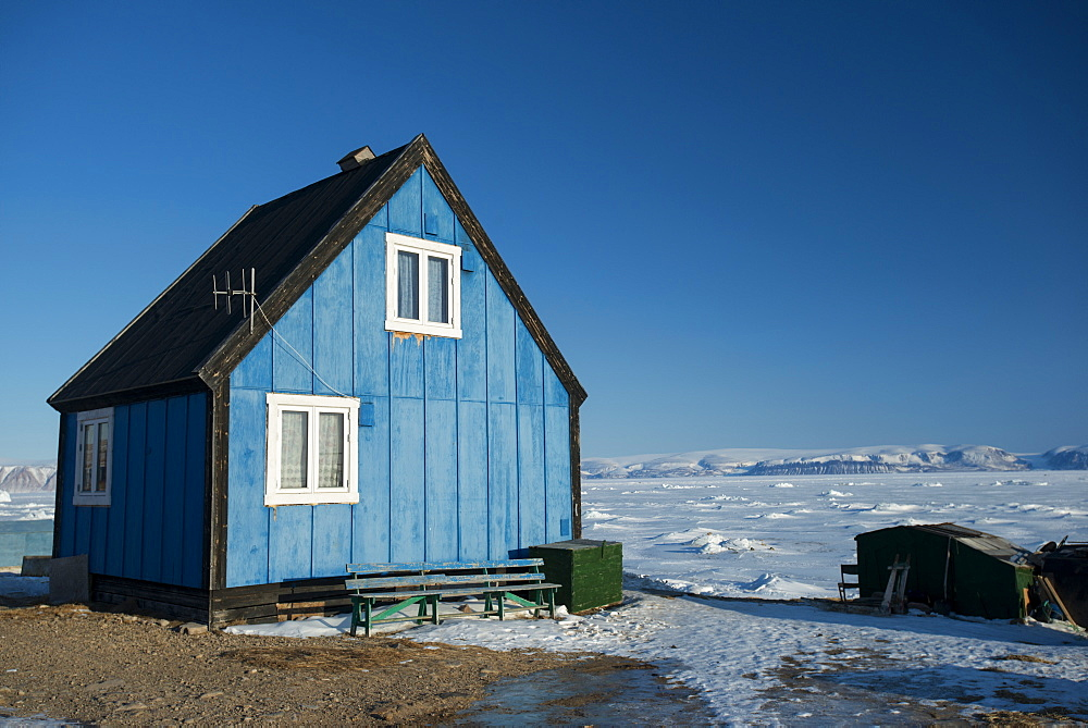 Colourful wooden house in the village of Qaanaaq, one of the most northerly human settlements on the planet and home to 656 mostly Inuit people, Greenland, Denmark, Polar Regions