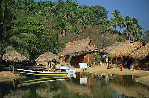 Boats and thatched huts at Mismaloya, near Puerto Vallarta, Mexico, North America