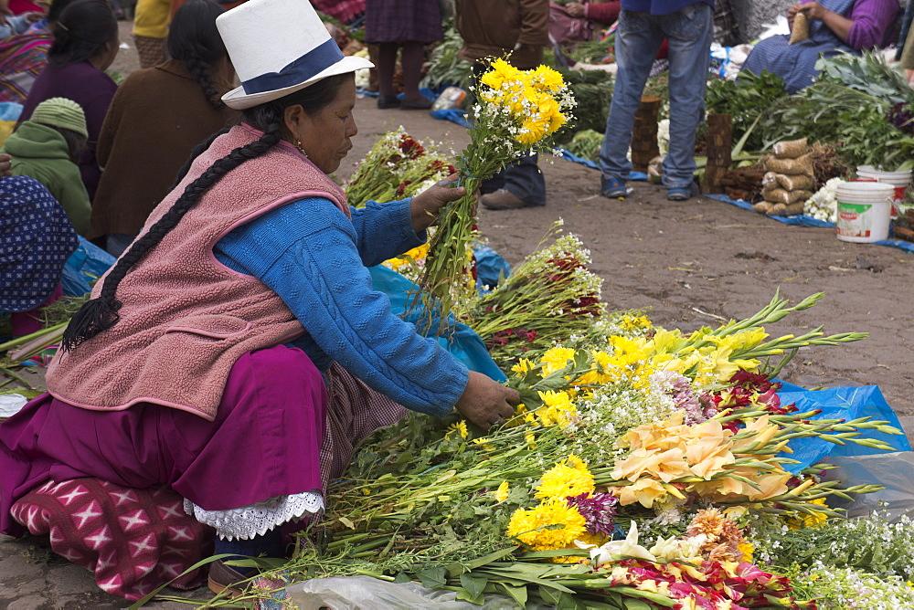 Flower seller at San Pedro market, Cuzco, Peru, South America