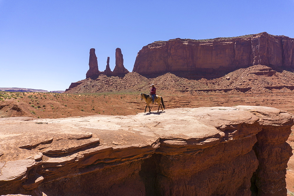 John Ford's Point and the Three Sisters and cowboy on horse, Monument Valley, border of Arizona and Utah, United States of America, North America - 483-2084