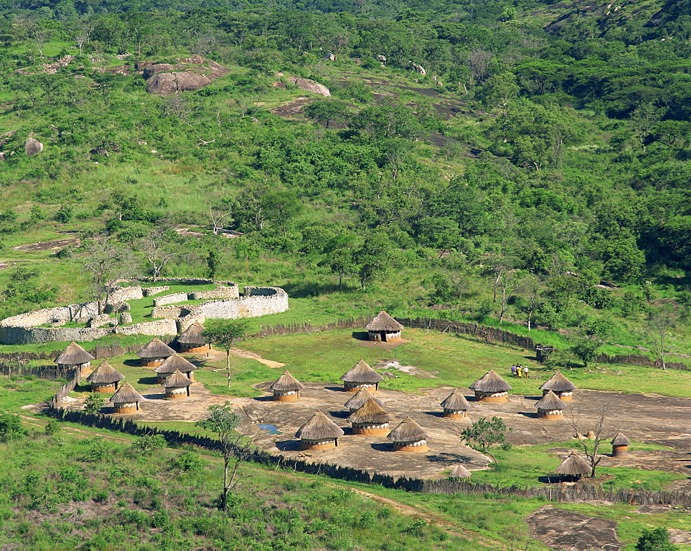 Nearby huts and Great Zimbabwe National Monument, UNESCO World Heritage Site, Zimbabwe, Africa