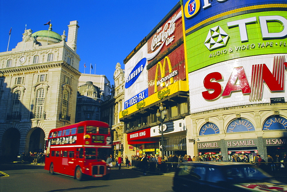 Double decker bus and advertisements, Piccadilly Circus, London, England, UK