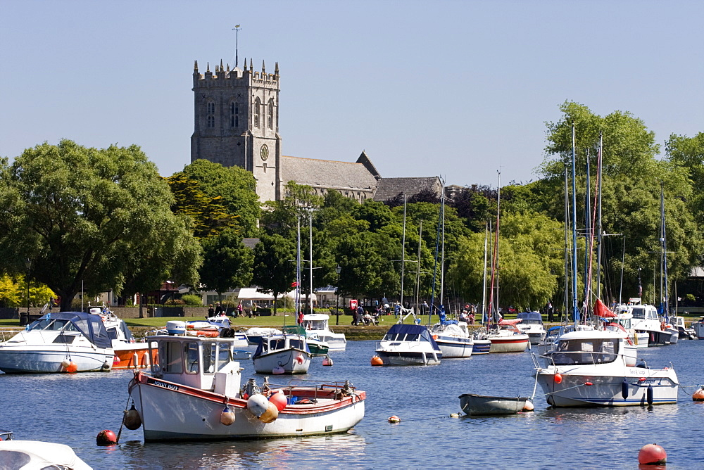 Christchurch Priory and pleasure boats on the River Stour, Dorset, England, United Kingdom, Europe