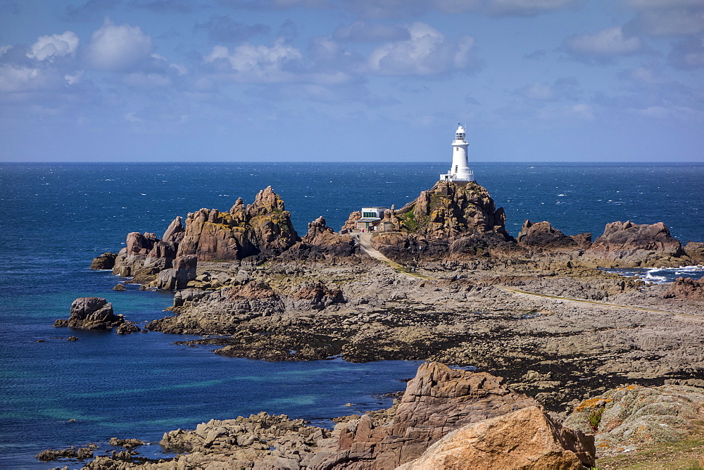Corbiere Lighthouse and rocky coastline, Jersey, Channel Islands, United Kingdom, Europe - 485-9677
