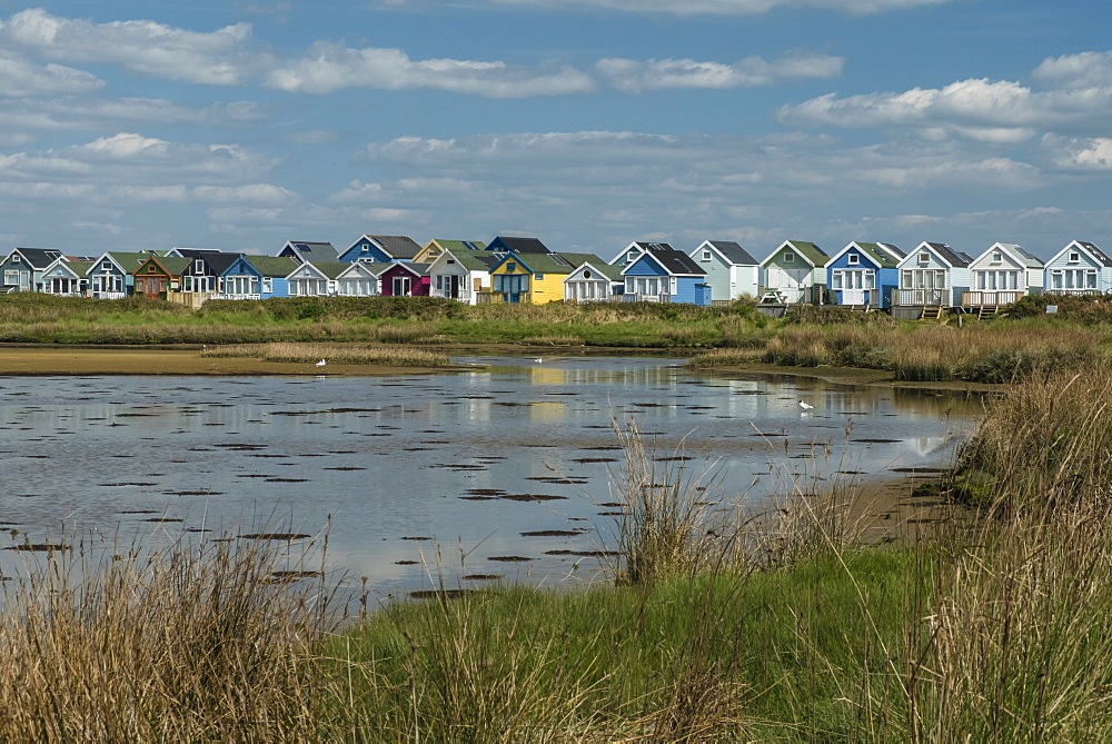 Beach huts and Lagoon, Mudeford Spit, Christchurch Harbour, Dorset, England, United Kingdom, Europe