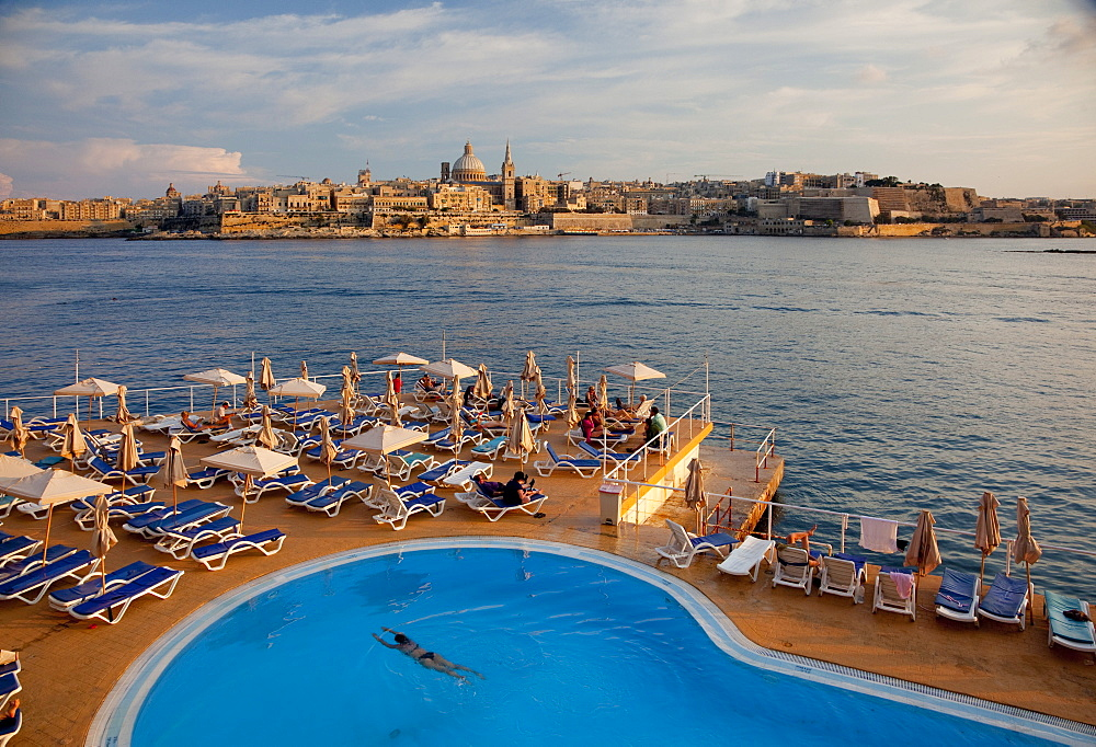 Valletta and dome of Carmelite Church from swimming pool in Sliema, Malta, Mediterranean, Europe