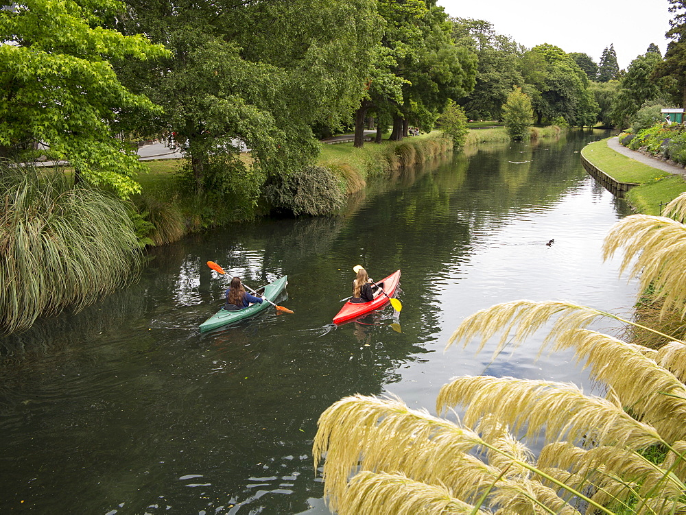 Two girls canoeing on the Avon River, Christchurch, Canterbury, South Island, New Zealand, Pacific