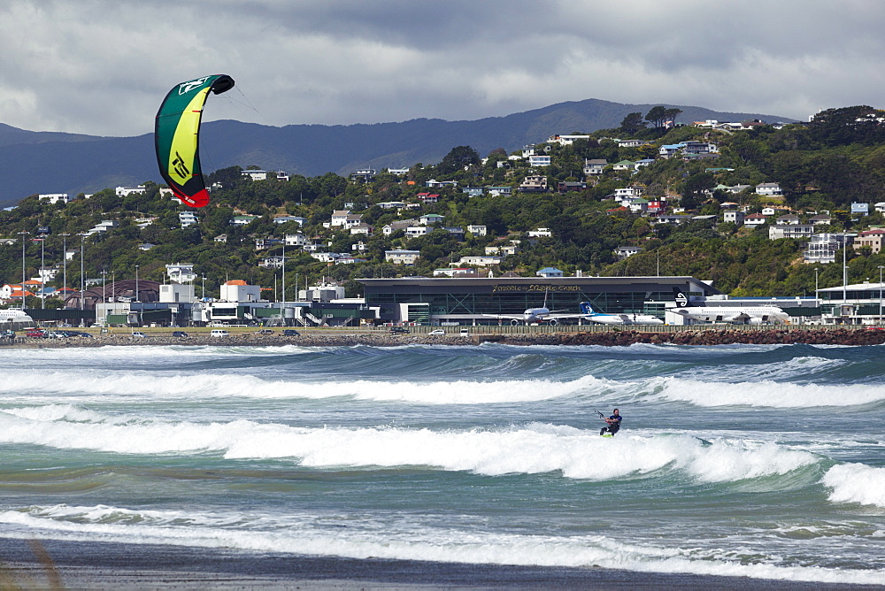 Kite surfer with airport in background, Lyall Bay, Wellington, North Island, New Zealand, Pacific