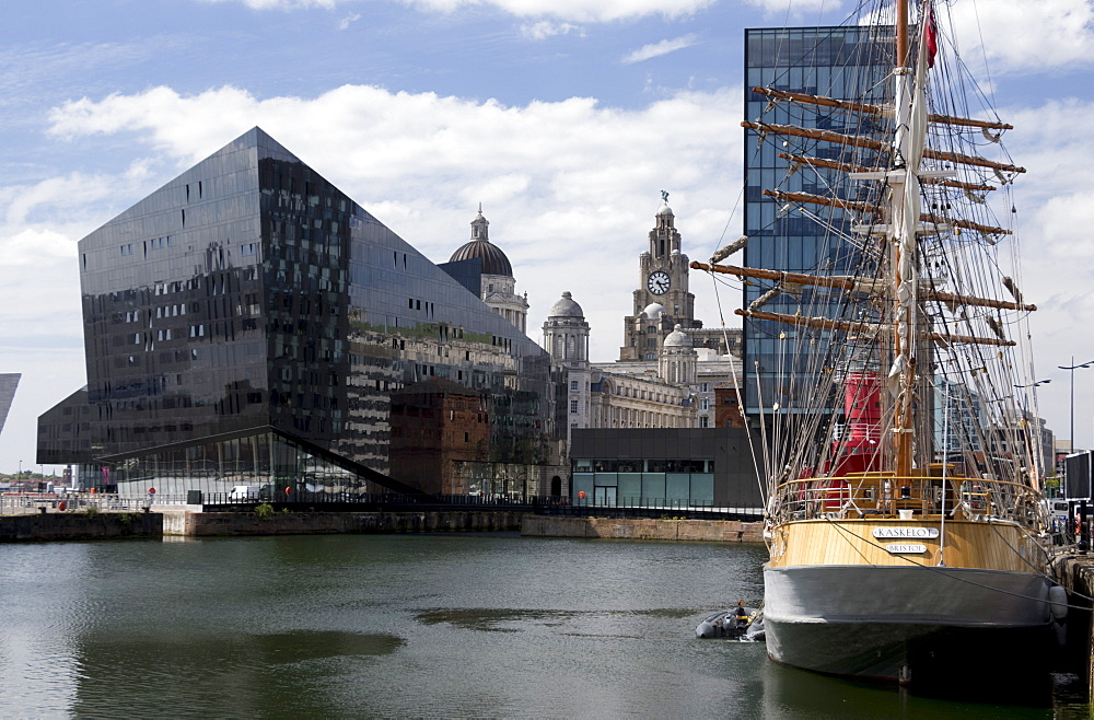 Part of Port of Liverpool Building and Royal Liver Building seen across Canning Dock with sailing ship Kaskelot, Liverpool, Merseyside, England, United Kingodm, Europe