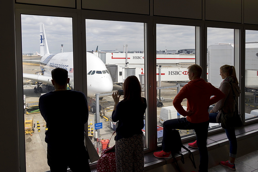 People looking through a window at an Airbus A380 of Malaysia Airlines at Kuala Lumpur International Airport, Malaysia, Southeast Asia, Asia - 489-1736