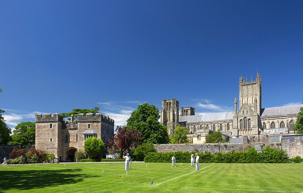 Wells Cathedral from Bishops Palace with croquet game, Wells, Somerset, England, United Kingdom, Europe - 489-1754