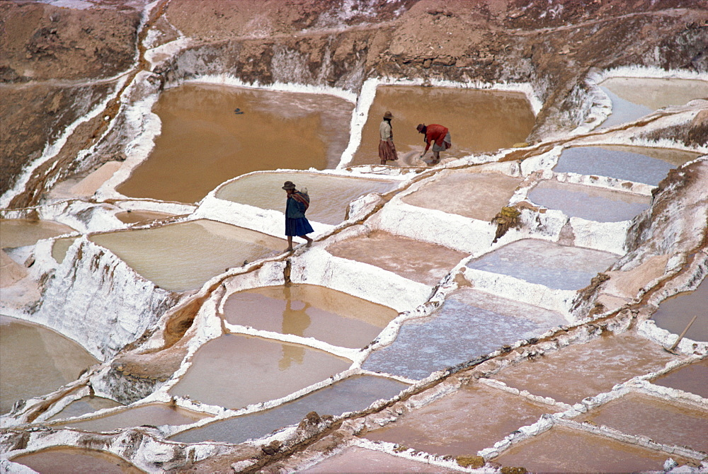Workers in the salt pans on terraces at Salinas, Cuzco, Peru, South America