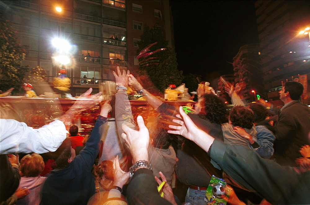 Murcia - Spain Spring Festivals - Burial of the Sardine Spectators reach out for gifts thrown from the floats