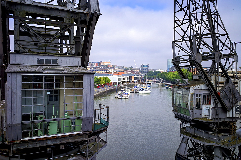 Old dockside cranes frame the harbour, Bristol, England, United Kingdom, Europe - 492-3542