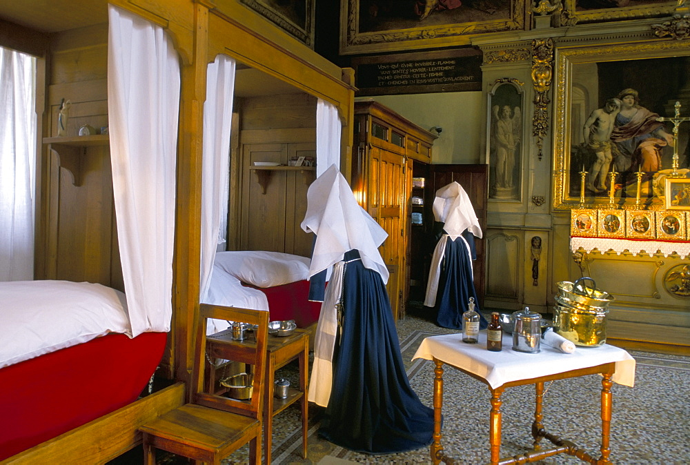 Tableau shows work of the nursing Sisters, Hotel Dieu, Beaune, Burgundy, France, Europe