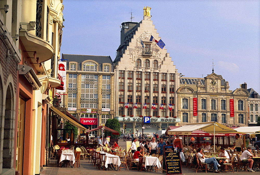 Pavement cafes and old buildings on the Grand Place in the city of Lille, Nord Pas de Calais, France, Europe