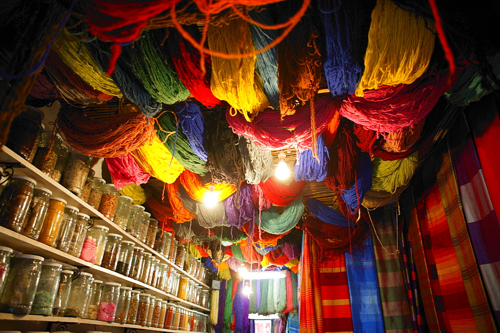 Brightly dyed wool hanging from roof of a shop, Marrakech, Morocco, North Africa, Africa *** Local Caption ***   - 526-3622