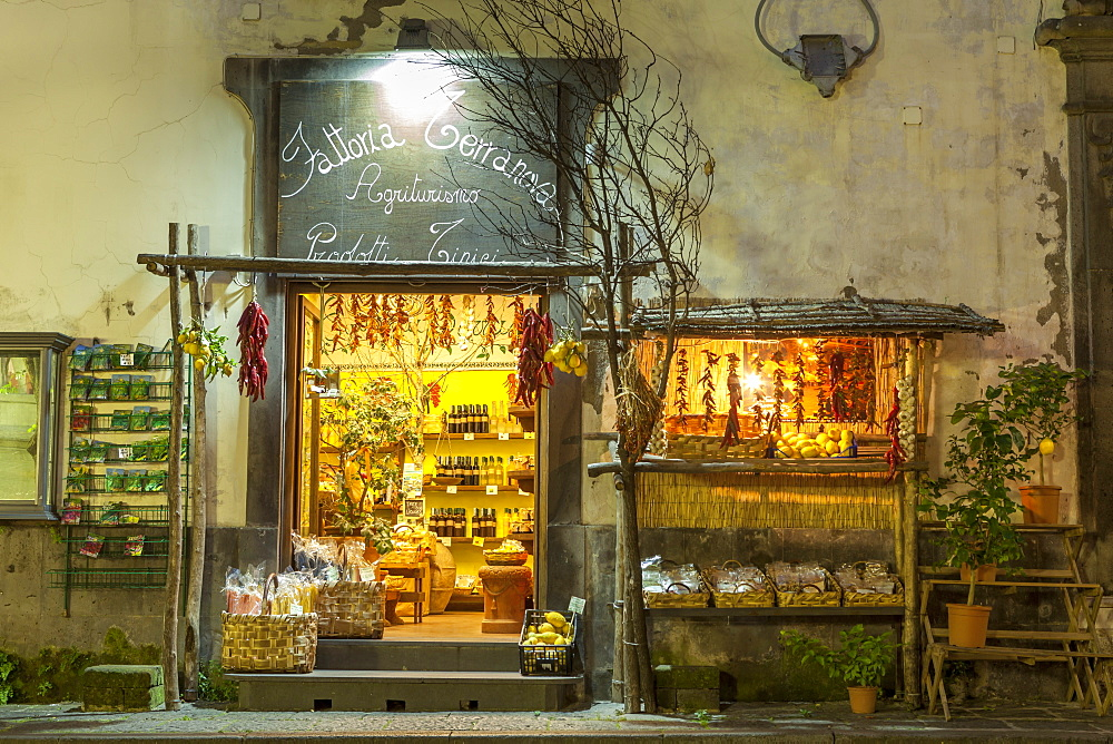 Shop lit up selling produce at night in the back streets of Sorrento, Campania, Italy, Europe - 526-3842