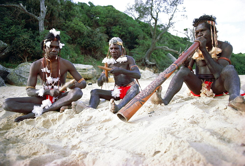Three Aborigines playing musical instruments, Northern Territory, Australia, Pacific