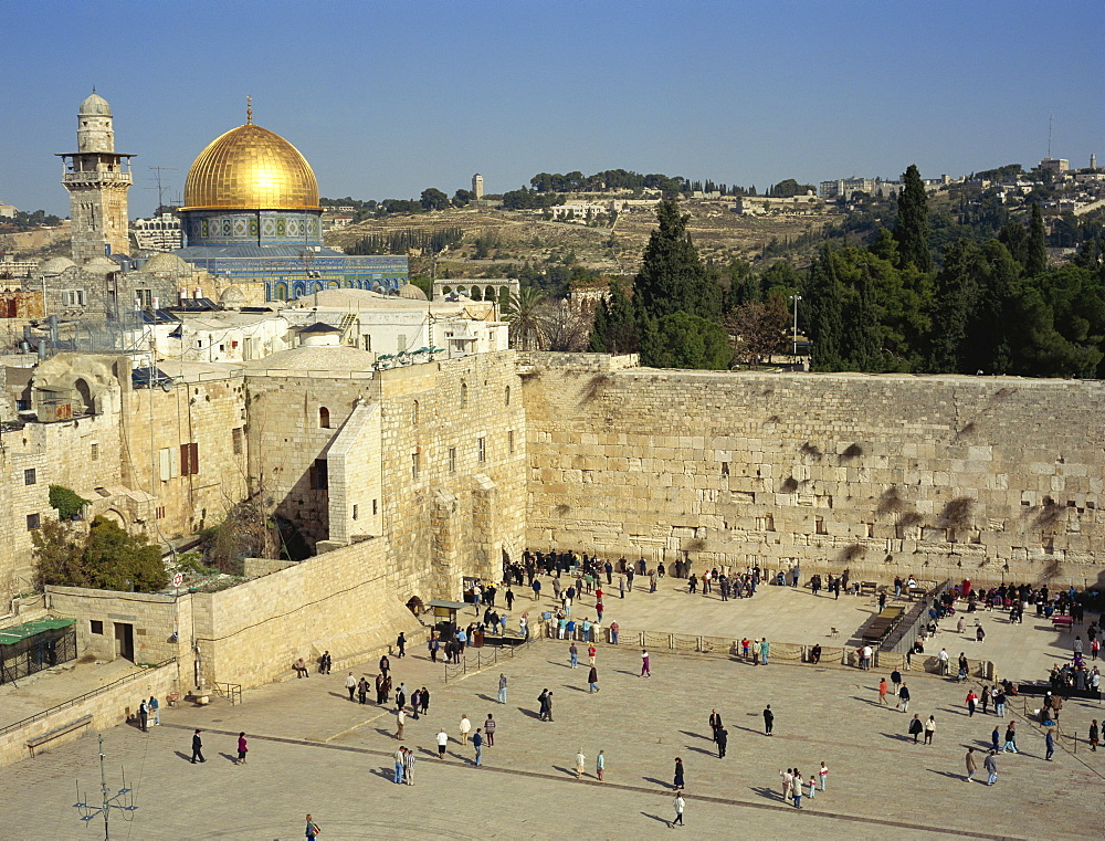Western or Wailing Wall, sacred site of Judaism, with the gold Dome of the Rock, sacred site of Islam, behind, in Jerusalem, Israel, Middle East