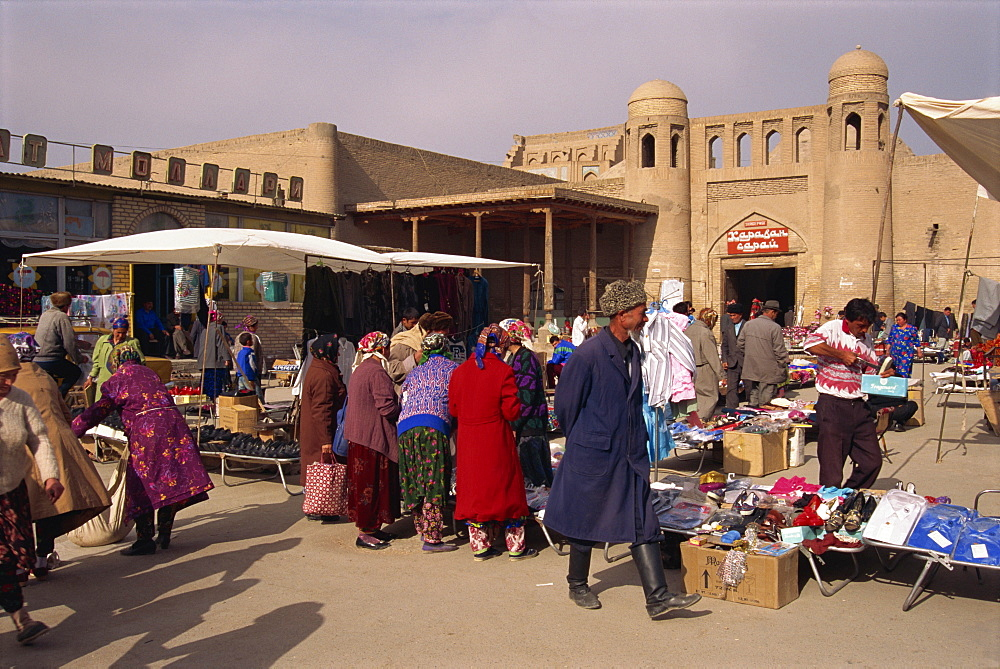 People in the bazaar at the West Gate of the city of Khiva, Uzbekistan, Central Asia, Asia