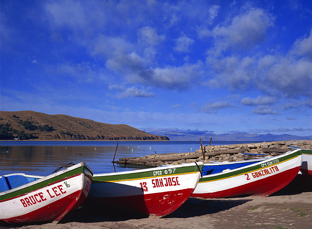 Three fishing boats pulled onto shore of Lake Titicaca, Copacabana, Bolivia, South America