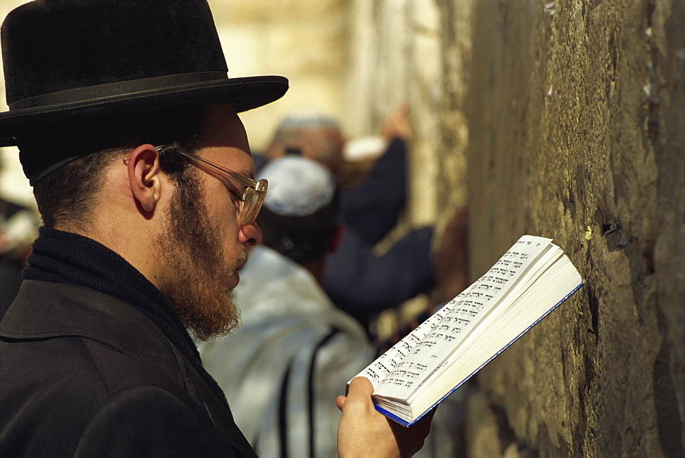 Close-up of Orthodox Jew praying with a book in his hand at the Western Wall in Jerusalem, Israel, Middle East