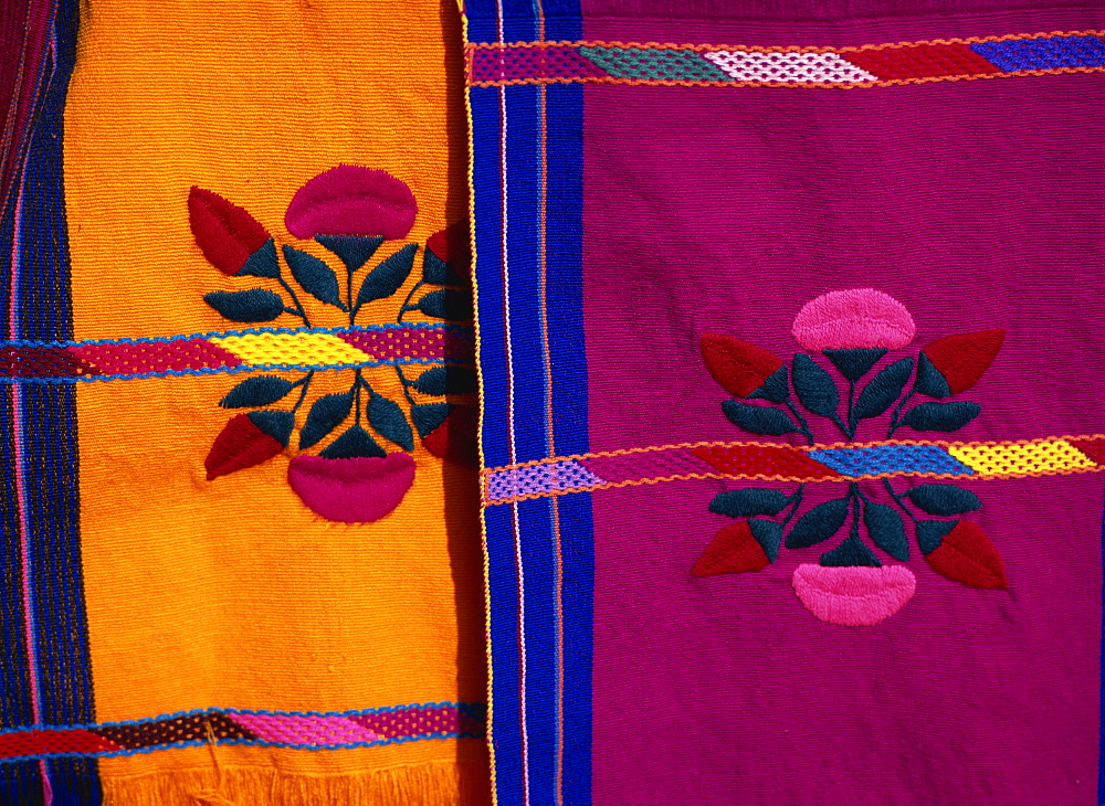 Brightly coloured craft rugs on display at San Cristobal de las Casas, in Chiapas, Mexico, North America