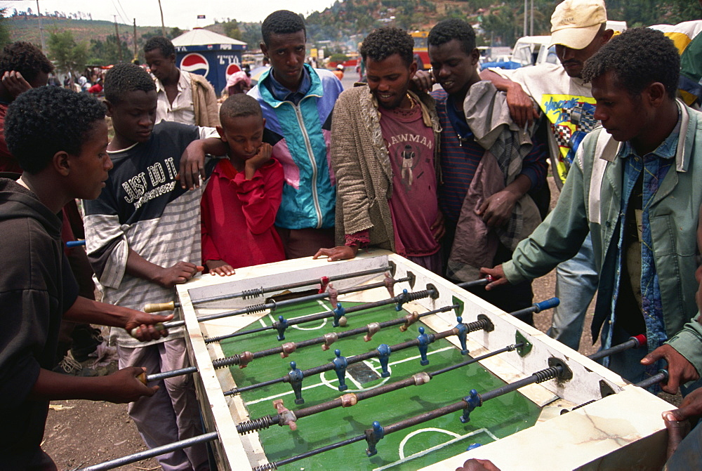 Boys playing table football, Addis Ababa, Ethiopia, Africa