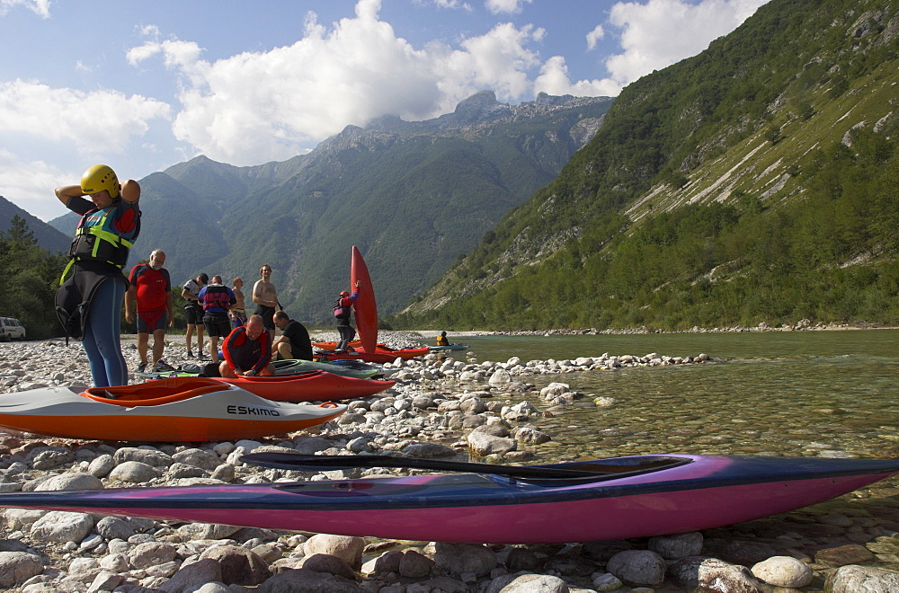 Group of people getting ready for canoeing on the Soca River, Triglav National Park, Julian Alps, Slovenia, Europe