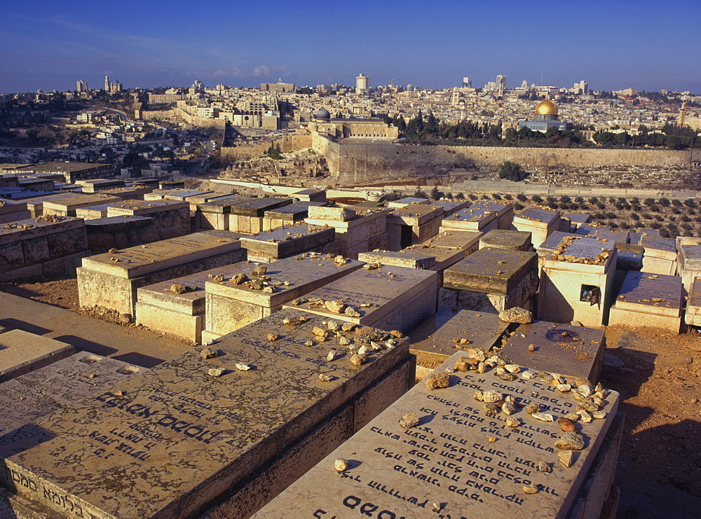 Jewish tombs in the Mount of Olives cemetery, with the Old City beyond, Jerusalem, Israel, Middle East