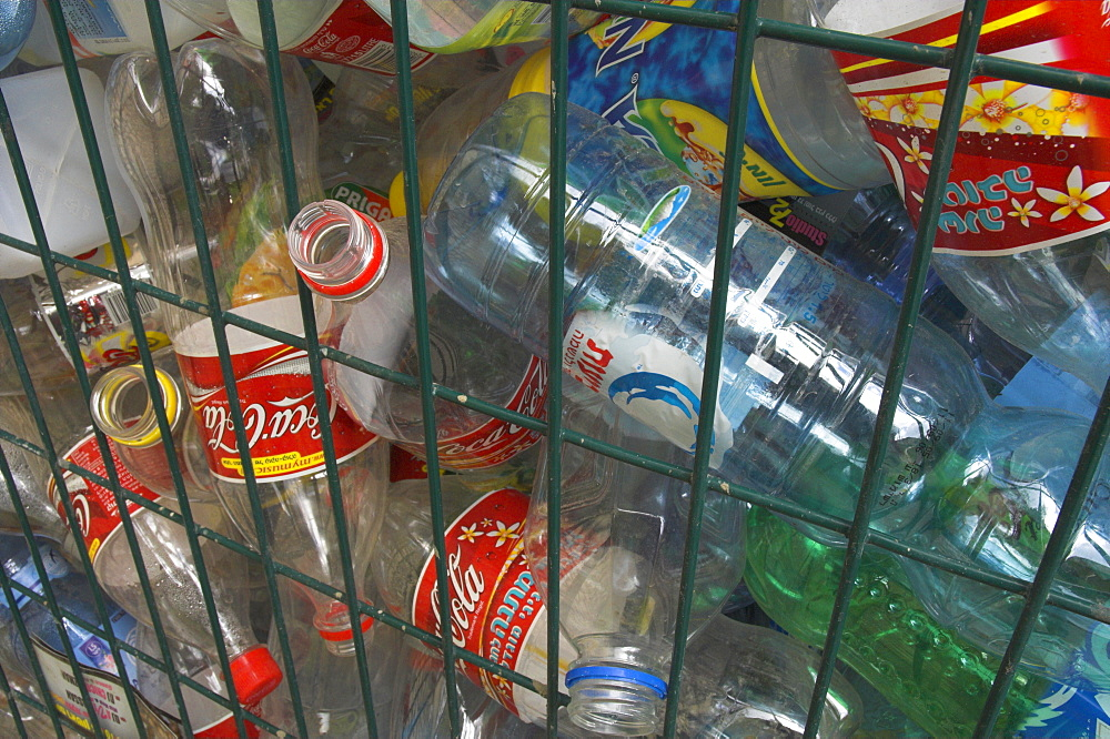 Empty plastic bottles in a recycling container - 557-2786