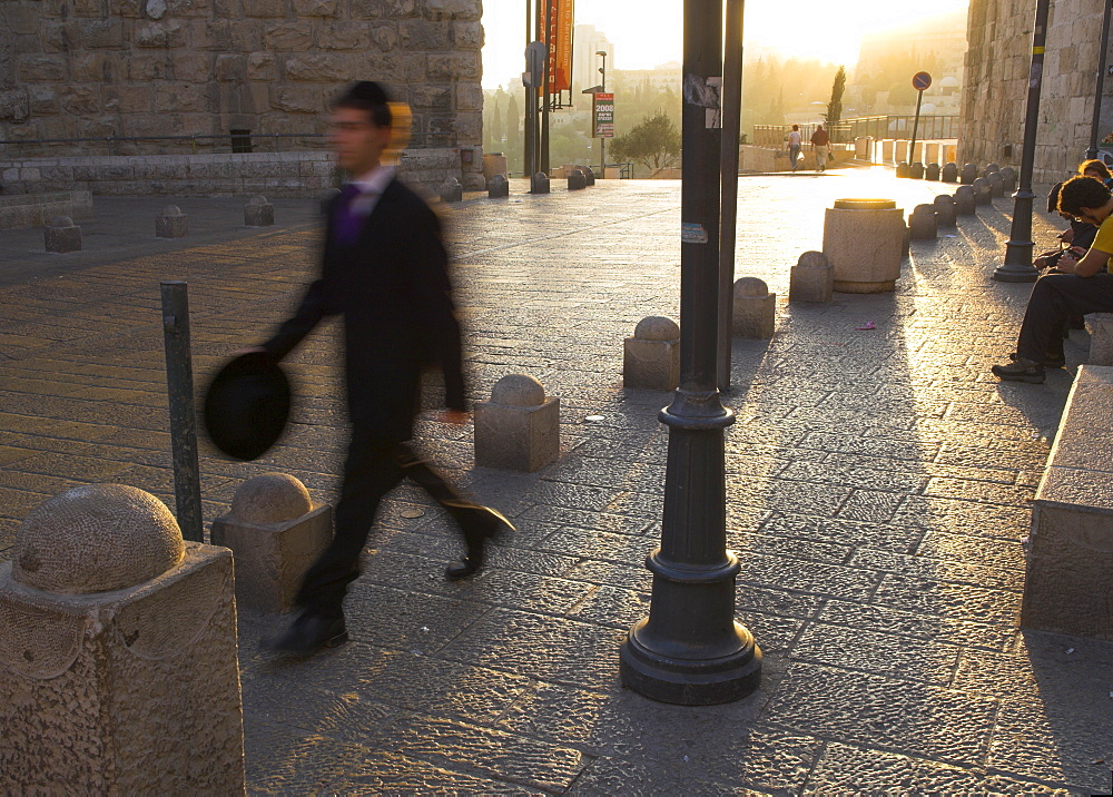 Young orthodox Jew dressed for the Sabbath prayers walking to the Western Wall at sunset, Jaffa Gate, Old City, Jerusalem, Israel, Middle East