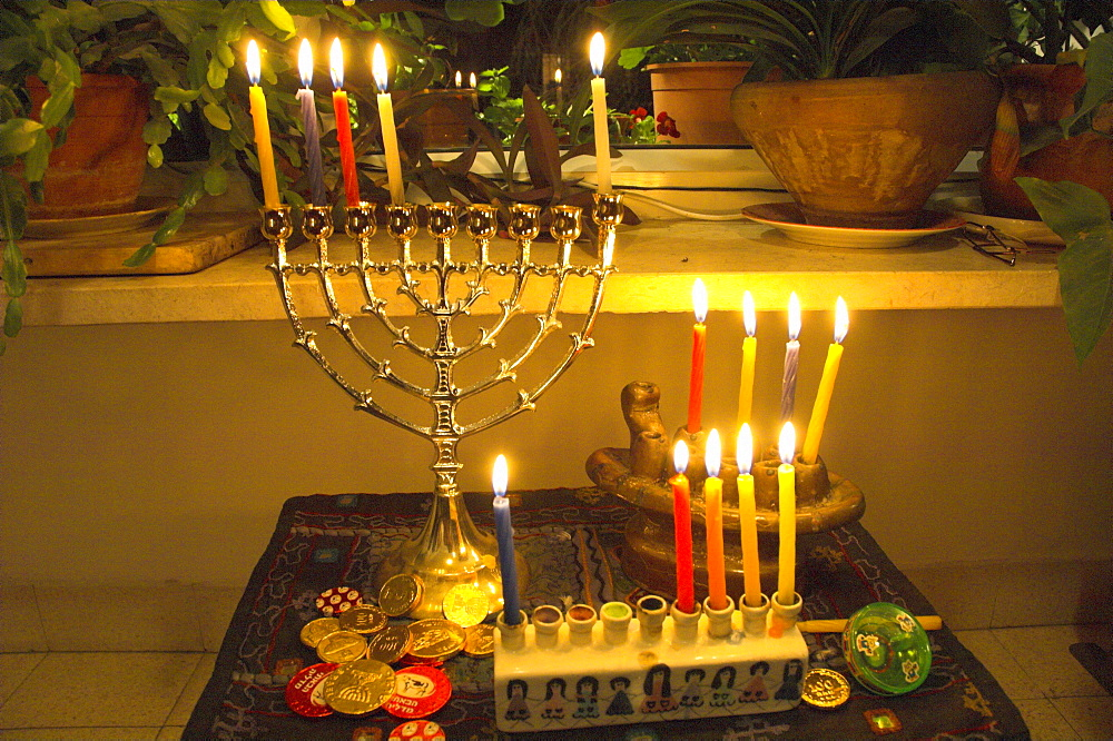 Jewish festival of Hanukkah, three hanukiah with four candles each, Jerusalem, Israel, Middle East