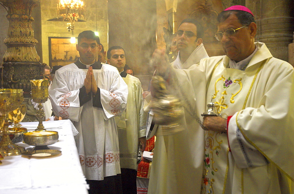 Monseigneur Fouad Boutros Tawal, Coadjutor of the Latin Patriarch of Jerusalem, swinging incense during Mass in Easter week, Church of the Holy Sepulchre, Old City, Jerusalem, Israel, Middle East